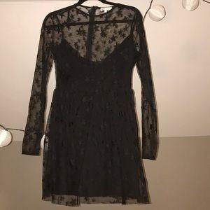 Revolve Black Mesh Star Dress